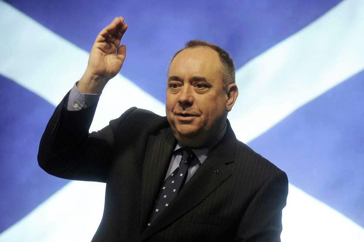 Scotland's First Minister Alex Salmond gestures during a press conference in St Andrews House in Edinburgh after signing an agreement for a referendum on Scottish independence with the British prime minister.Texas secessionists are looking to Scotland's potential independence for a pathway to independence here.