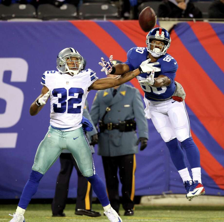 Cowboys cornerback Orlando Scandrick held Giants Pro Bowl receiver Victor Cruz to just two receptions for 47 yards and forced him to fumble early in Dallas' crucial road victory. Photo: Peter Morgan / Associated Press