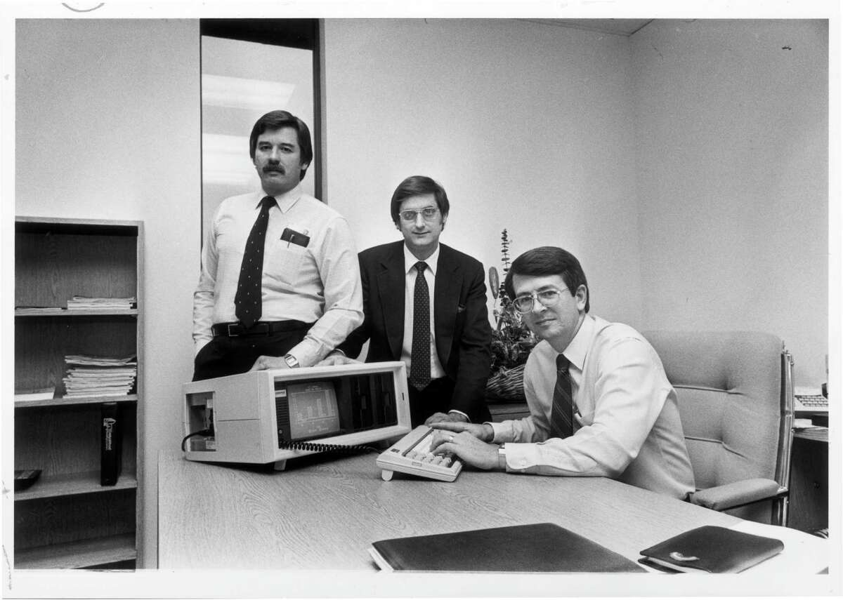 Compaq Computer Corp. founders Jim Harris, left, Bill Murto and Rod Canion show off one of their computers in 1983.