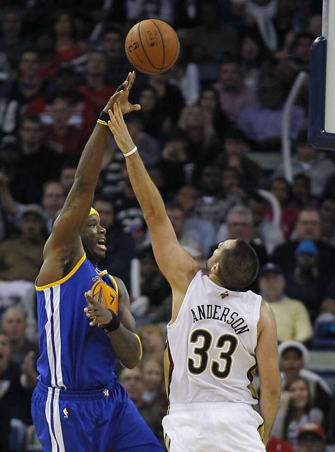Jermaine O'Neal flips a shot over the Pelicans' Ryan Anderson in the second half. Photo: Gerald Herbert, Associated Press