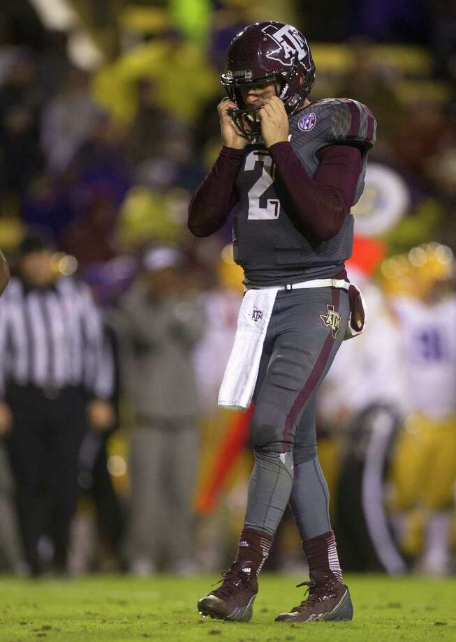 Johnny Manziel, whose thumb injury apparently was news to offensive coordinator Clarence McKinney on Tuesday, had his worst game as an Aggie in Saturday's loss at LSU. Photo: Cody Duty / Houston Chronicle