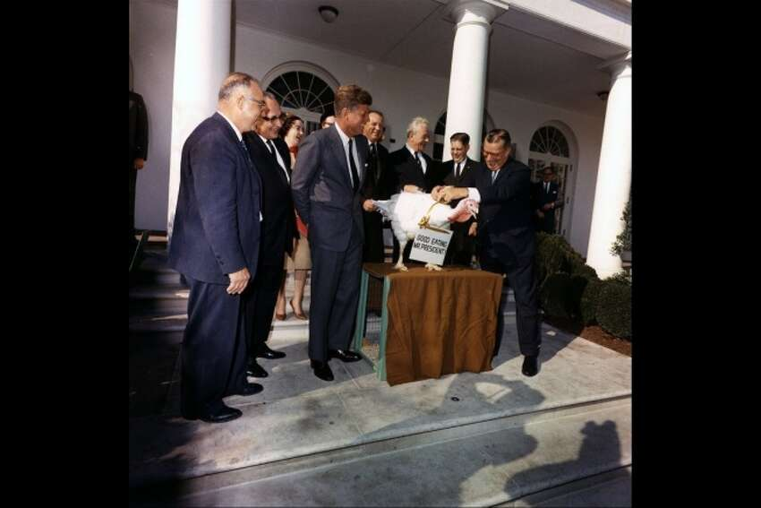 Presentation of a Thanksgiving turkey to John F. Kennedy. Senator Everett Dirksen accompanies members of the Poultry and Egg National Board and the National Turkey Federation in the Rose Garden, November 19, 1963.
