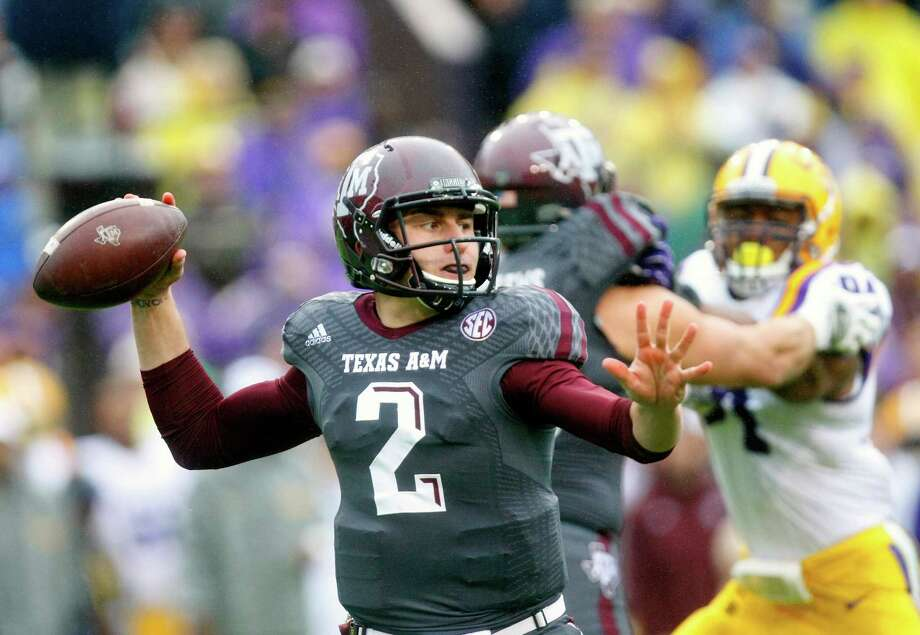 Picking Johnny Manziel likely would require the Texans to trade down in the first round. Photo: Cody Duty, Staff / © 2013 Houston Chronicle