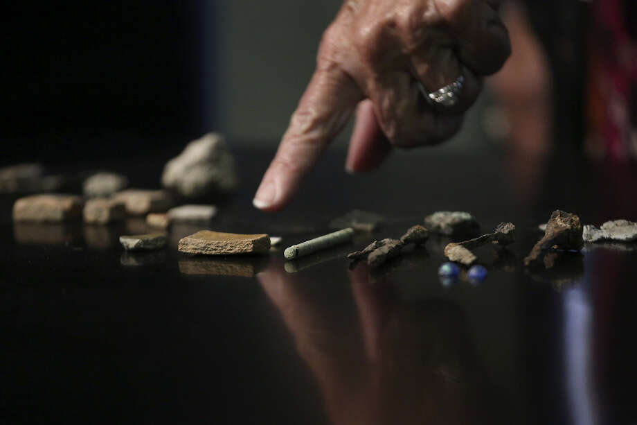 City Archaeologist Kay Hindes points to artifacts found on property owned by the Christopher Columbus Italian Society. Photo: Lisa Krantz / San Antonio Express-News