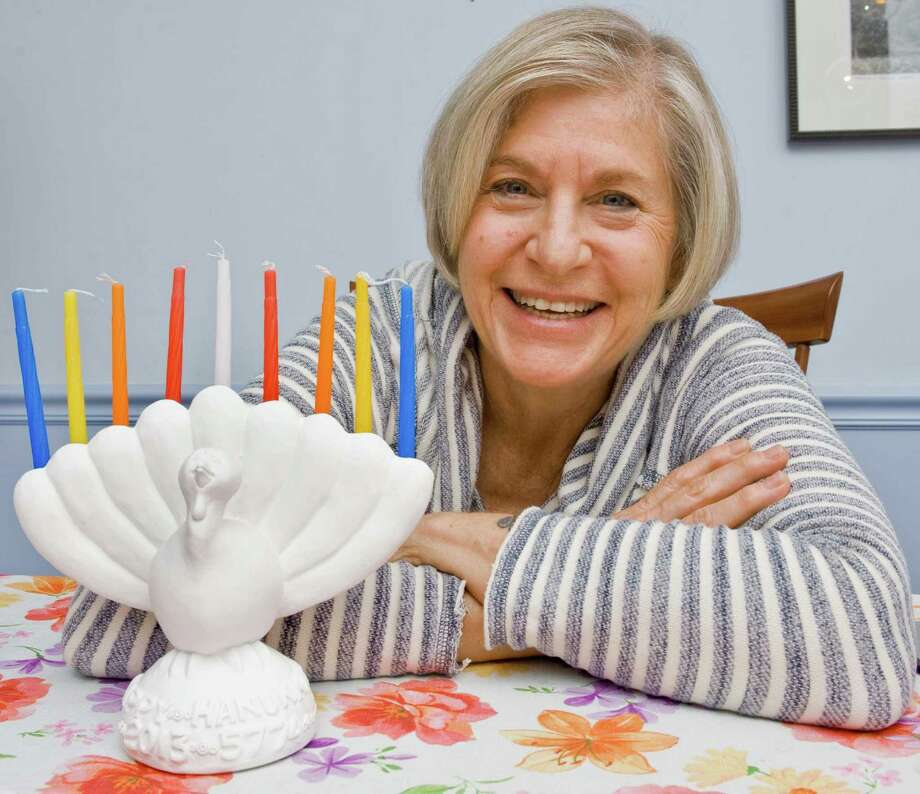 """Mary Miller, of Ridgefield, shows her """"menurkey,"""" a combination menorah and turkey. Miller purchased the clay menorah at the Jewish Museum in New York City.   Tuesday, Nov. 26, 2013 Photo: Scott Mullin, Scott Mullin/For The News-Times / The News-Times Freelance"""
