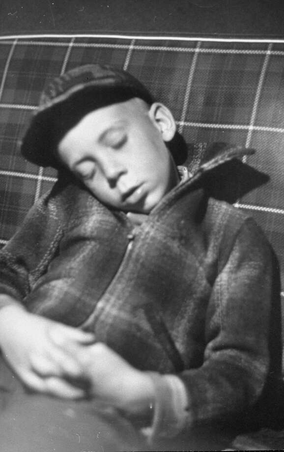 Exhausted Mike Gipson sleeping in car after 1949 coon hunt. Photo: Thomas D. McAvoy, Time & Life Pictures/Getty Image