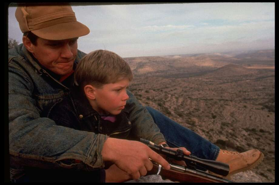 8-yr-old Kemper Cowden with father, Lynn, during first deer hunt & male initiation, near the Pecos Bend ranch in 1991. Photo: Kevin Horan, Time & Life Pictures/Getty Image