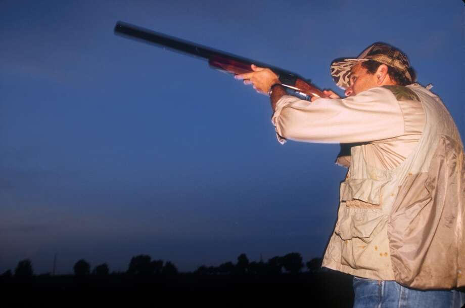 Texas Governor George W. Bush takes a shot on the first day of Dove hunting season in Hockley, Texas, September 1, 1994. Photo: Paul S. Howell, Getty Images