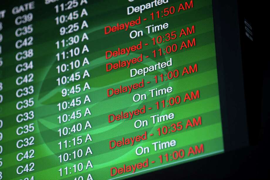 An airport monitor shows that a number of flights are delayed at Tampa International Airport, Tuesday morning, Nov. 26, 2013, in Tampa, Fla. Travelers are facing delays due to winter storms in other areas of the country.   TAMPA OUT; CITRUS COUNTY OUT; PORT CHARLOTTE OUT; BROOKSVILLE HERNANDO OUT; USA TODAY OUT; MAGS OUT Photo: Eve Edelheit, AP / Tampa Bay Times