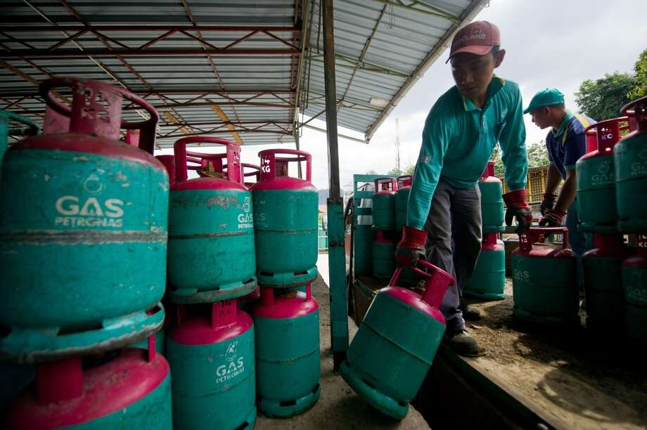 20. Petroliam Nasional Berhad (Petronas) -- state oil company of Malaysia  2012 rank -- 20  [Photo: A worker unloads an empty Petronas gas cylinder at a shop in Ampang, in the suburbs of Kuala Lumpur on November 14, 2013.] Photo: MOHD RASFAN, AFP/Getty Images