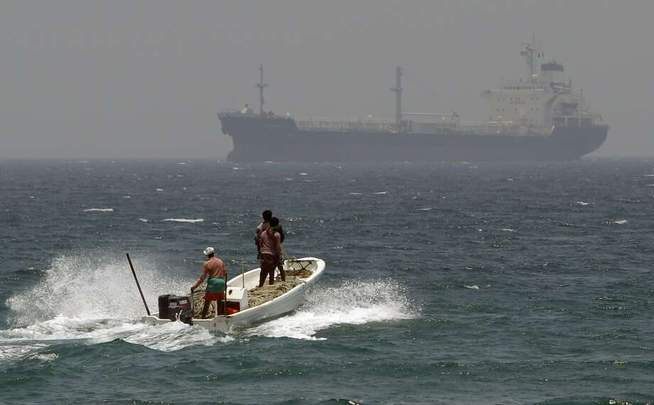 18. Abu Dhabi National Oil Company (ADNOC) -- national oil company of the United Arab Emirates  2012 rank -- 18  [Photo: With an oil tanker in background, fishermen cross the sea waters off  Fujairah, United Arab Emirates in 2012.] Photo: Kamran Jebreili, Associated Press
