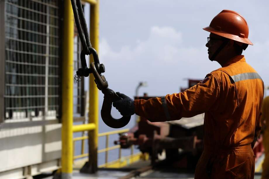 11. Petróleos Mexicanos (Pemex) -- national oil company of Mexico  2012 rank -- 11  [Photo: An oil worker holds the hook of a crane at the Centenario deep-water drilling platform off the coast of Veracruz, Mexico in 2013.] Photo: Dario Lopez-Mills, Associated Press