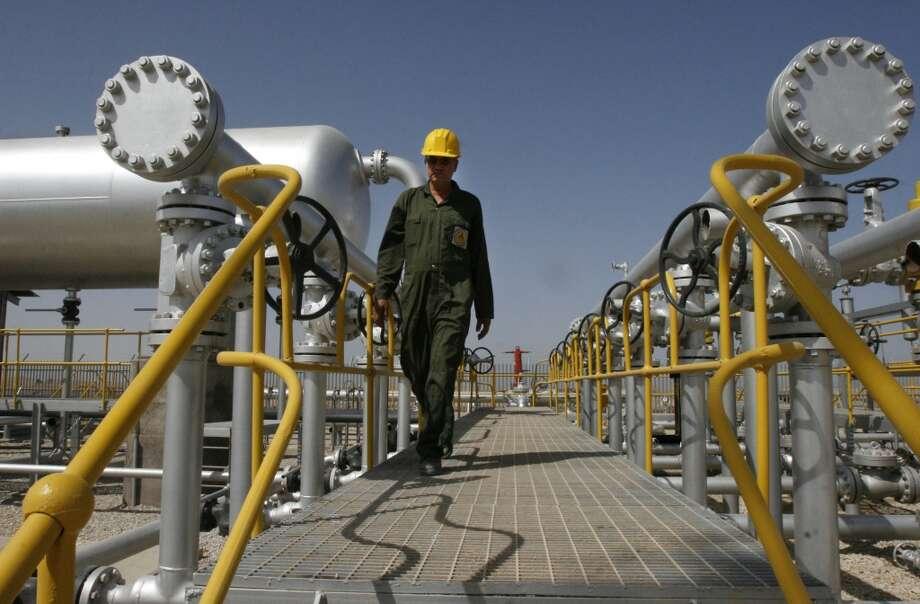 2. National Iranian Oil Company (NIOC) -- national oil company of Iran  2012 rank -- 2  [Photo: Iranian oil technician Majid Afshari makes his way to the oil separator facilities in Iran's Azadegan oil field southwest of Tehran, Iran.] Photo: Vahid Salemi, Associated Press