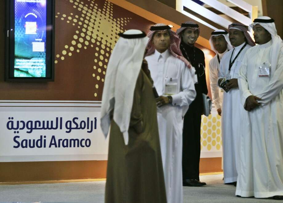 1. Saudi Aramco -- national oil company of Saudi Arabia  2012 rank -- 1  [Photo: Employees of the Saudi Aramco oil company prepare for the first day of the Arab Oil and Gas exhibition in Dubai, United Arab Emirates in 2007. ] Photo: Kamran Jebreili, Associated Press
