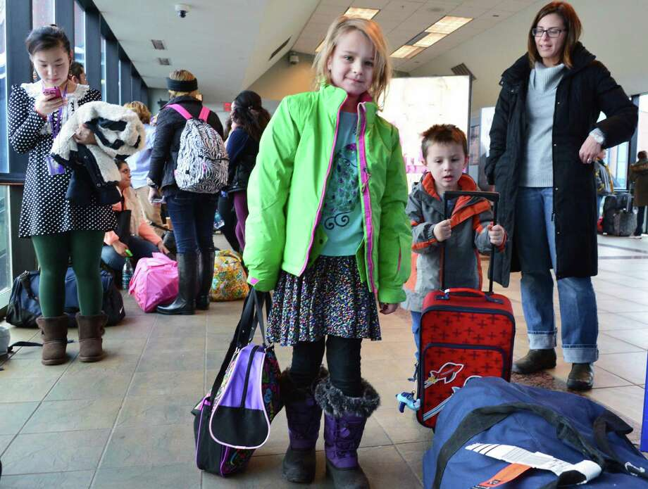 Six-year-old Jordan Frank , center, of Denver, little brother Liam Frank, 3,  and mother Melinda Pollack, at right, board the train to NYC at the Rensselaer Train Station Tuesday Nov. 26, 2013, in Rensselaer, NY. In the area visiting family in Clifton Park, they are now on their way to celebrate Thanksgiving with relatives in NYC.  (John Carl D'Annibale / Times Union) Photo: John Carl D'Annibale, Albany Times Union / 00024804A