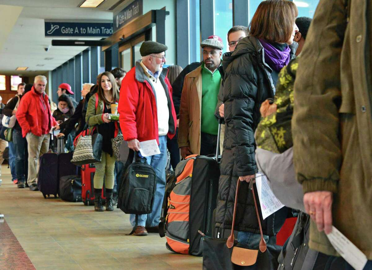 Holiday travelers queue up for the train to NYC at the Rensselaer Train Station Tuesday Nov. 26, 2013, in Rensselaer, NY. (John Carl D'Annibale / Times Union)
