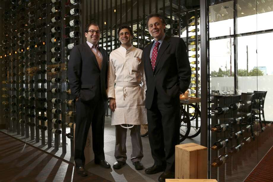 Vallone's partners Scott Sulma, chef Grant Gordon and Tony Vallone standing in the wine room at Vallone's. Photo: Karen Warren, Houston Chronicle