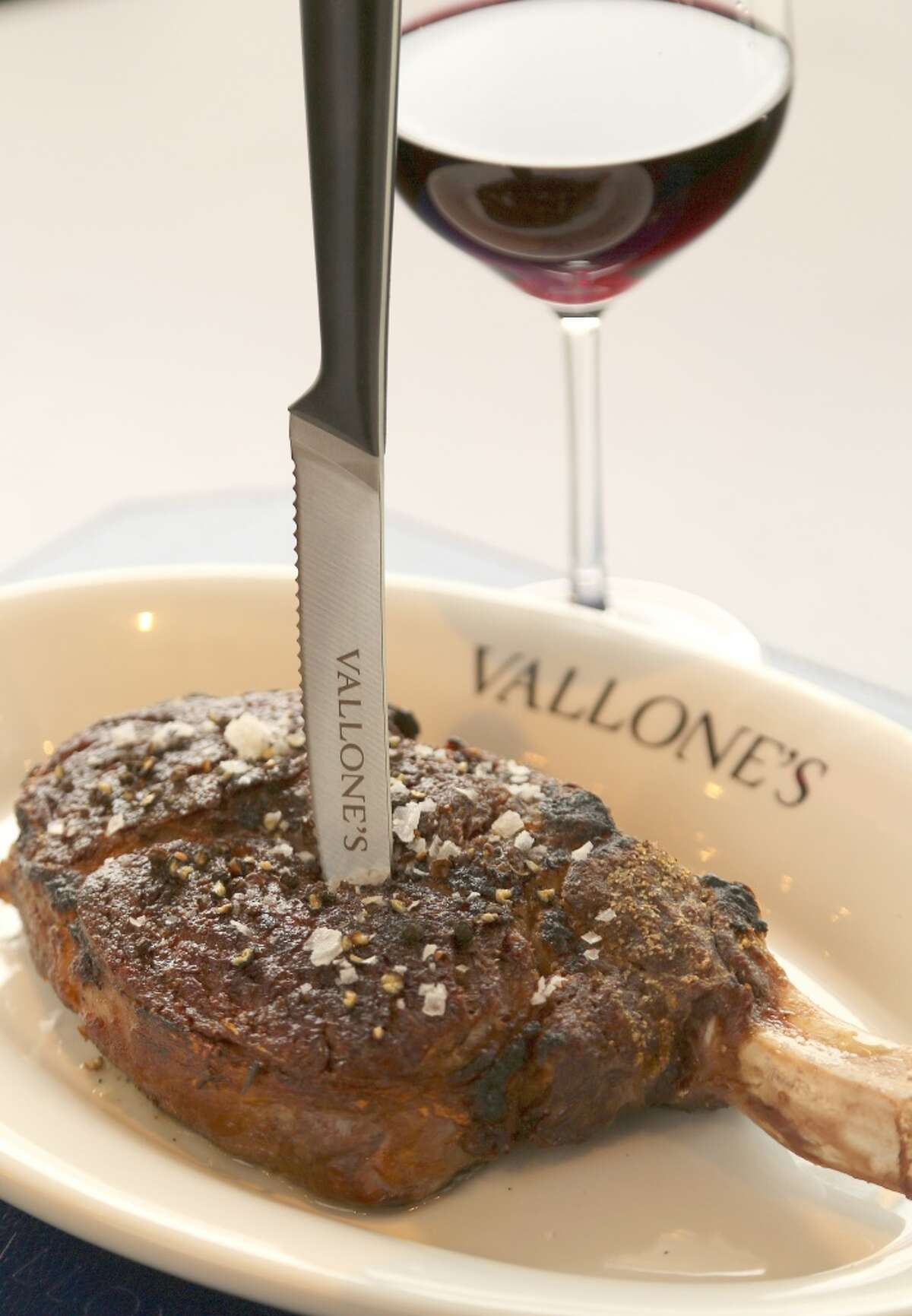 Fifty-five-day dry aged bone-in ribeye at Vallone's.