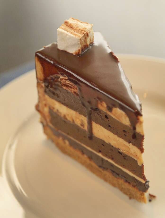 Peanut butter and English toffee cake at Vallone's. Photo: Karen Warren, Houston Chronicle