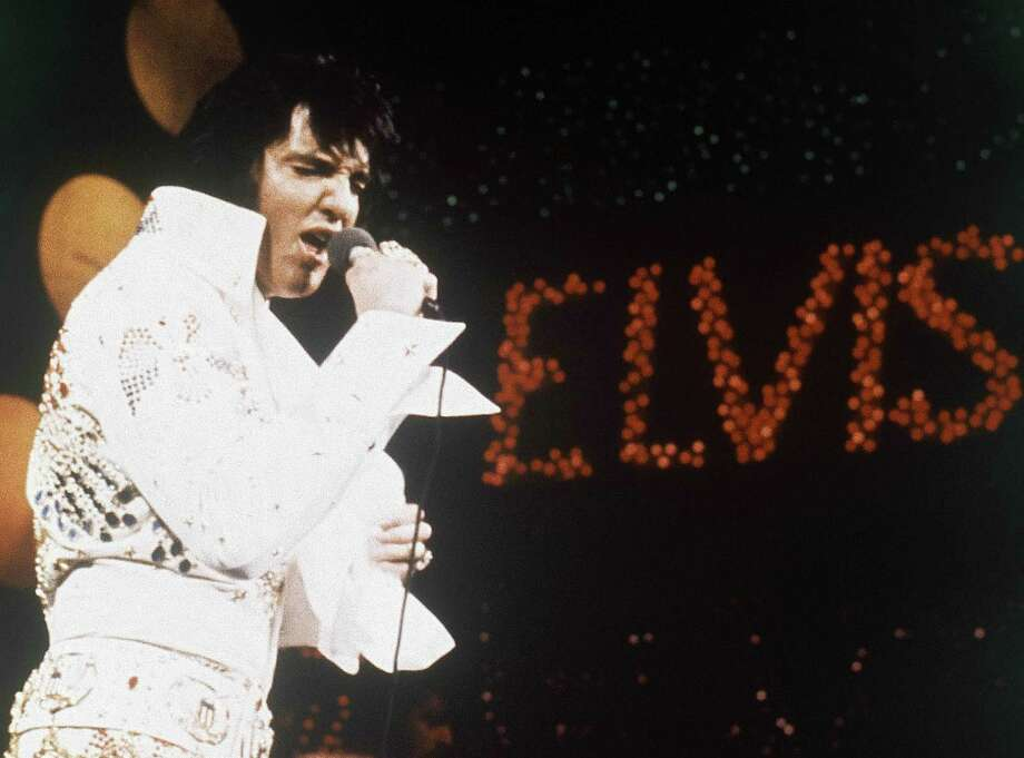 This 1972 file photo shows Elvis Presley  during a performance. A three-CD box set slated for release the first week of August  2013 chronicles two recording sessions by Elvis Presley at the renowned Stax Records in Memphis in 1973.  (AP Photo, files) (AP Photo, file) Photo: Associated Press