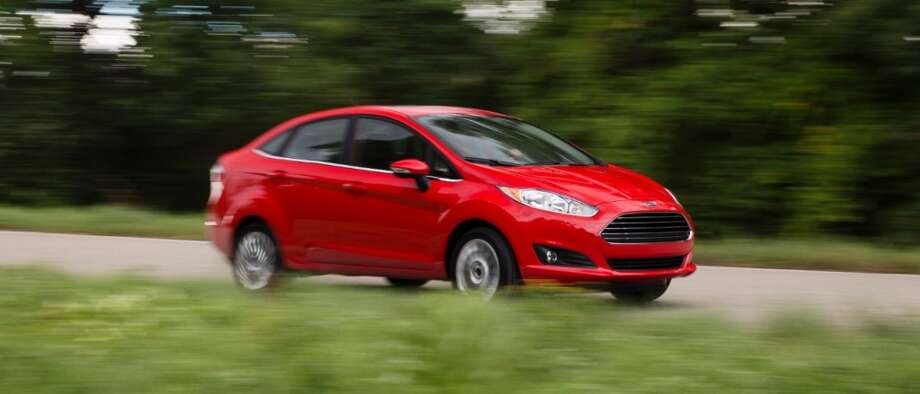 The 4-door Fiesta looks pretty sporty on the road. Photo: Ford