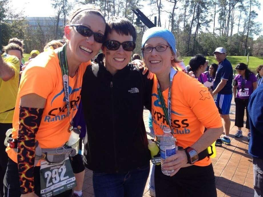 Bridget Oldenburg, center, along with Jennifer Laughlin, left, and K.C. DeGuise, will represent the Cypress Running Club at the 2014 Boston Marathon in April.