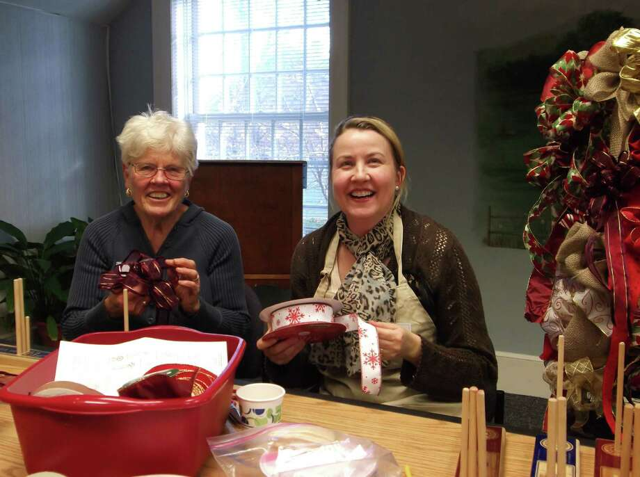 Alma Kearns, left, and Janelle Mason, right, make bows in preparation for Newtown Garden Club's annual Christmas Greens Sale, set for Saturday, Dec. 7. Photo: Contributed Photo/Ginnie Carey, Contributed Photo / The News-Times Contributed