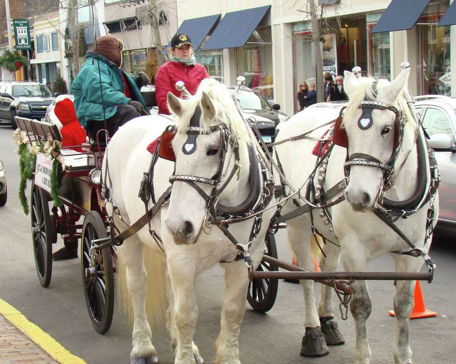 As in past years, horse-drawn carriages will give downtown holiday shoppers free rides, courtesy of the Westport Downtown Merchants Association. Rides will be available from noon to 4 p.m. on Dec. 14, 15, 21 and 22. Photo: Contributed Photo / Westport News