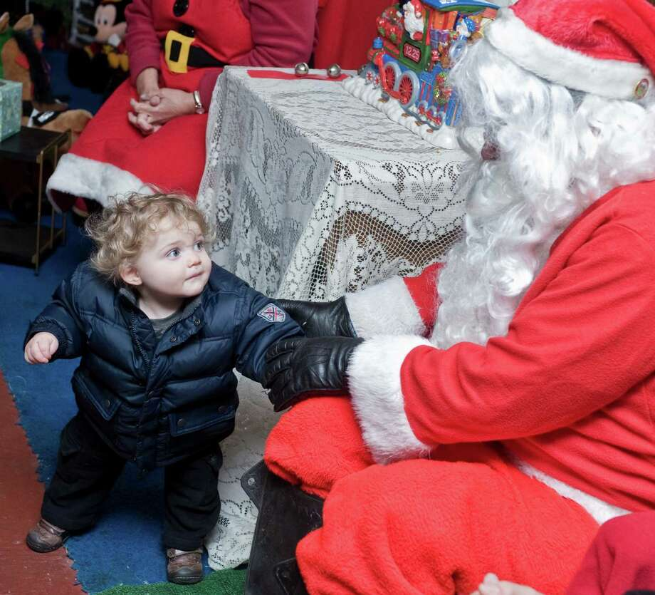 Gavin Blatt of Danbury visits with Santa on his special coach after riding on the Santa Express train at the Danbury Railway Museum. Photo: Scott Mullin, ST / The News-Times Freelance