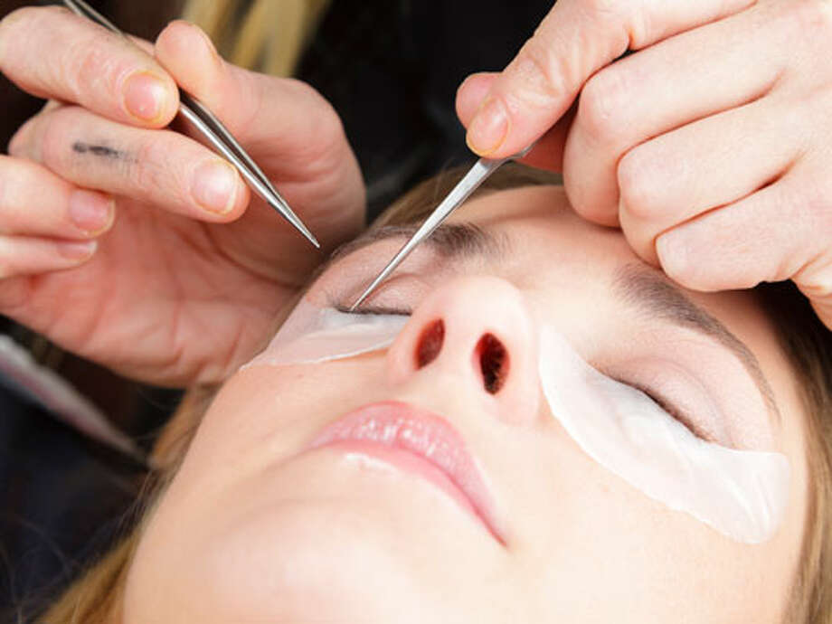 Lash Extensions: DIYProfessional lash extensions — in which a single lash is bonded to each of your own top lashes — can easily set you back a couple hundred dollars and require touch-ups every few weeks. Drugstore lashes, however, can create a dramatic effect for a fraction of the cost.For the most natural look, choose individual lashes labeled short and knot-free, says Balsamo. First, apply eye makeup including mascara. Then dip the end of an individual lash (which are actually small clusters) into a pea size amount of glue and apply it to the middle of the eye, above the pupil. This creates a youthful, open look. Stop there, or, for a fuller look, dip your next lash into the bead of glue and work towards the outer corners. Avoid placing lashes only at the outer corners, says Balsamo, as it can make eyes appear droopy. For the fullest look, place a few lashes toward the inner corners. Photo: Rich Legg/iStock / © Rich Legg