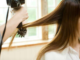 """Blow Out: Pro    When you need a blowout with staying power (that can last through a few days of events) or you want a look you're not comfortable tackling yourself (waves on straight hair or straightened-out curls), a salon appointment is the only way to go. """"The main advantage to a pro blowout is the longevity,"""" says MariLynne Mele, stylist at Blow, the New York Blow Dry Bar. """"It also makes hair shiny, bouncy, and polished, and instantly makes a woman feel pulled together.""""  To prolong a salon blow dry, use a shower cap since humidity can cause frizz. Sleep with your locks pulled into a very loose bun at the top of your head, secured with a hairpin (a hair band can leave dents). Use a dry shampoo to absorb oils near roots and scalp so hair feels clean and refreshed.  Can't make it to the salon this month? It's possible to get similar results at home, says Mele. The secret? Apply an alcohol-free styling lotion to damp hair to help tame frizz; dry hair completely (if it feels cool to the touch, it's still damp and more likely to frizz); and use the right brush. """"The bigger the brush, the straighter the hair,"""" says Mele."""