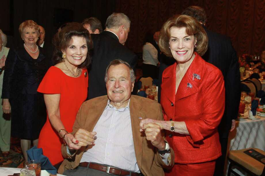 (For the Chronicle/Gary Fountain, November 21, 2013) Linda McReynolds, from left, President George H. W. Bush and Jeanie Kilroy Wilson at the Salvation Army luncheon. Photo: Gary Fountain, Freelance / Copyright 2013 Gary Fountain.