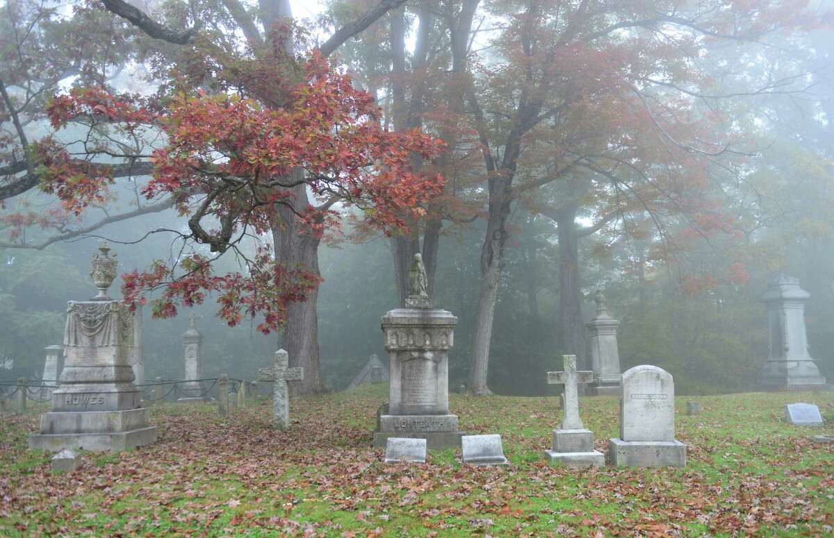 Early morning fog blankets the graves of Albany Rural Cemetery Thursday, Oct. 10, 2013, in Menands, N.Y. (Will Waldron/Times Union)