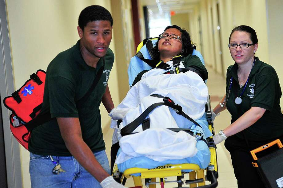 San Jacinto College Emergency Medical Technology students (from left) Jarred Goudeau, Ashley Alvarez and Rachel Pfardrescher get valuable hands-on training in the college's well-equipped allied health classroom facilities. Instructors at San Jacinto College say there is high demand for workers in virtually every healthcare career field, and EMT is no exception.