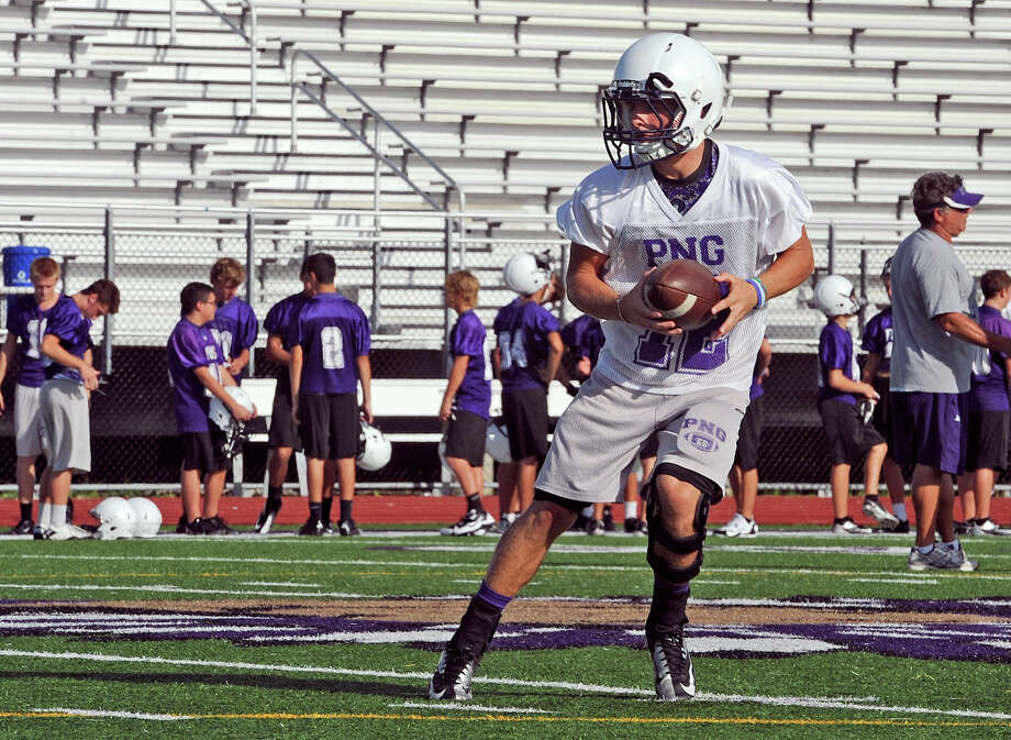 Port Neches-Groves Ky Walker steps back to throw the ball during practice at the Reservation.  Walker and the Indians are coming off a dramatic three-overtime win over Central last Friday.  Guiseppe Barranco/The Enterprise Photo: Guiseppe Barranco, STAFF PHOTOGRAPHER / The Beaumont Enterprise