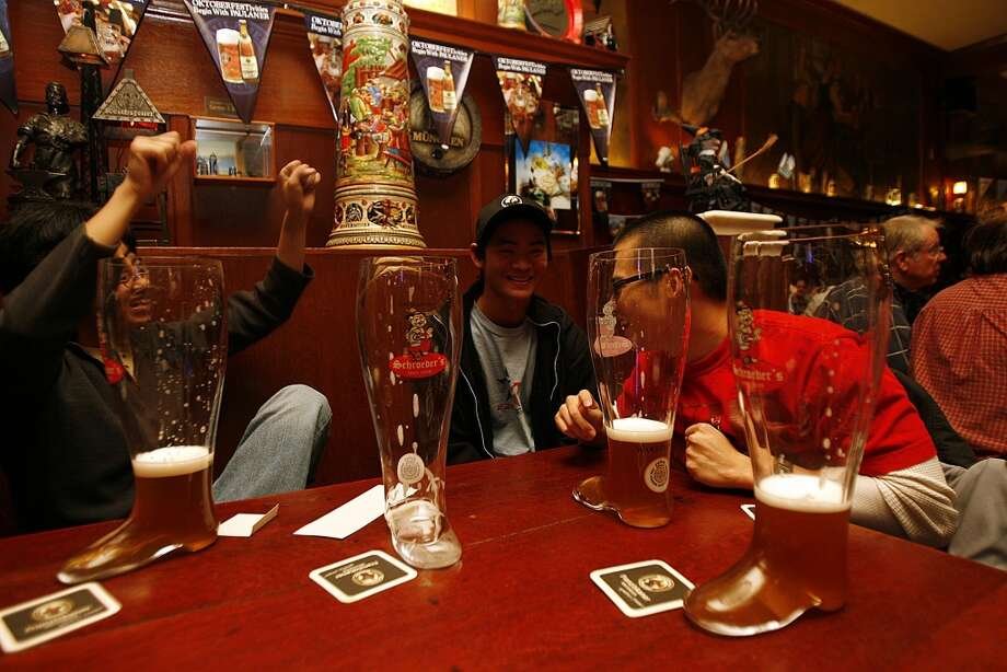 A Financial District tradition: Boots of beer at Schroeder's. Photo: Liz Hafalia, The Chronicle