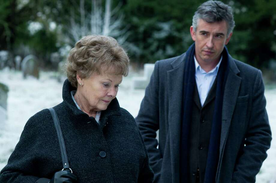 "This image released by The Weinstein Company shows Judi Dench, left, and Steve Coogan in a scene from ""Philomena."" The British comic and Oscar-winning actress co-star in the film opening Friday, Nov. 22, 2013, which explores the benefits and costs of faith through the true story of Philomena Lee. (AP Photo/The Weinstein Company, Alex Bailey) ORG XMIT: CAET562 Photo: Alex Bailey / The Weinstein Company"