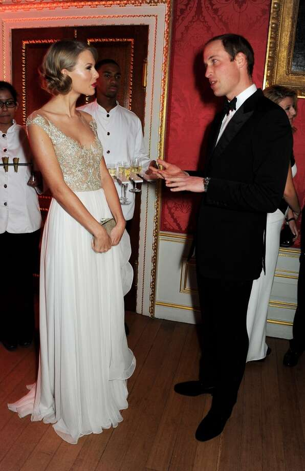 Taylor Swift (L) and Prince William, Duke of Cambridge, attend the Winter Whites Gala in aid of Centrepoint at Kensington Palace on November 26, 2013 in London, England.  (Photo by David M.Benett/Centrepoint/Getty Images for Centrepoint) Photo: David M.Benett/Centrepoint