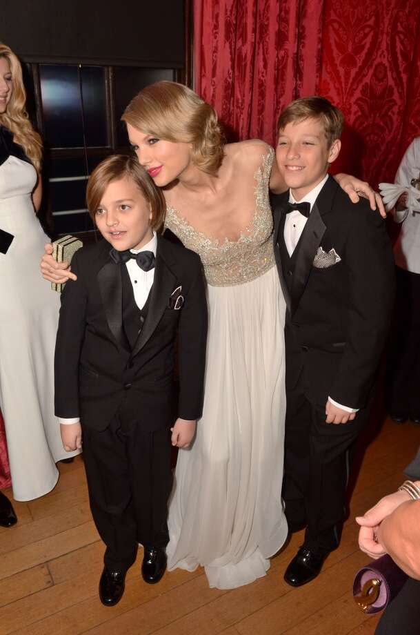 Taylor Swift poses with Jon Bon Jovi's children Romeo (L) and Jacob (R) at Kensington Palace for the Centrepoint Winter Whites Gala on November 26, 2013 in London, England.  (Photo by Dominic Lipinski - WPA Pool/Getty Images) Photo: WPA Pool, Getty Images