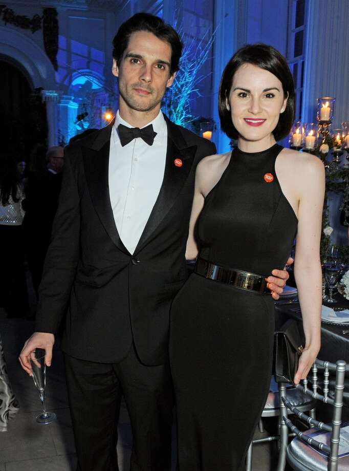John Dineen (L) and Michelle Dockery attend the Winter Whites Gala in aid of Centrepoint at Kensington Palace on November 26, 2013 in London, England.  (Photo by David M.Benett/Centrepoint/Getty Images for Centrepoint) Photo: David M.Benett/Centrepoint