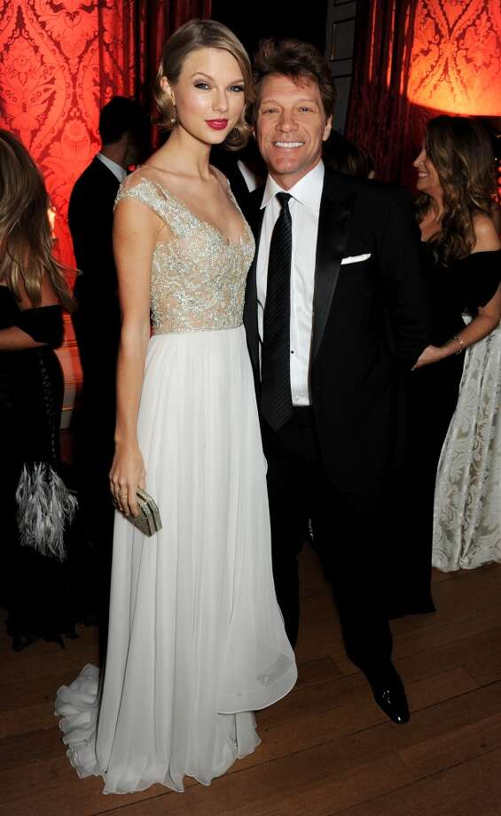 Taylor Swift (L) and Jon Bon Jovi attend the Winter Whites Gala in aid of Centrepoint at Kensington Palace on November 26, 2013 in London, England.  (Photo by David M.Benett/Centrepoint/Getty Images for Centrepoint) Photo: David M.Benett/Centrepoint