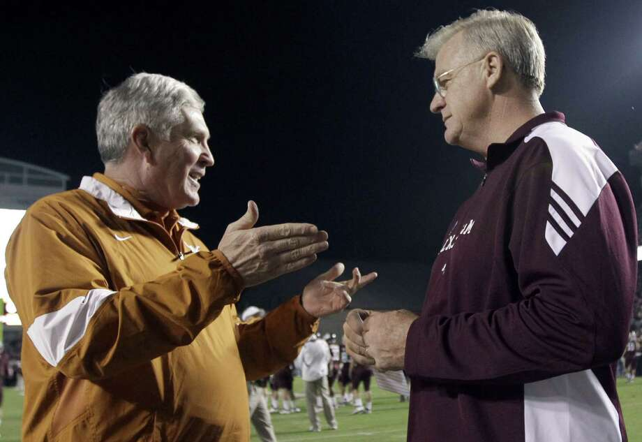 Texas head coach Mack Brown (left), talks with former Texas A&M head coach Mike Sherman before their Thanksgiving Day game in 2011. One of our readers says the teams should renew their football rivalry. Photo: Associated Press