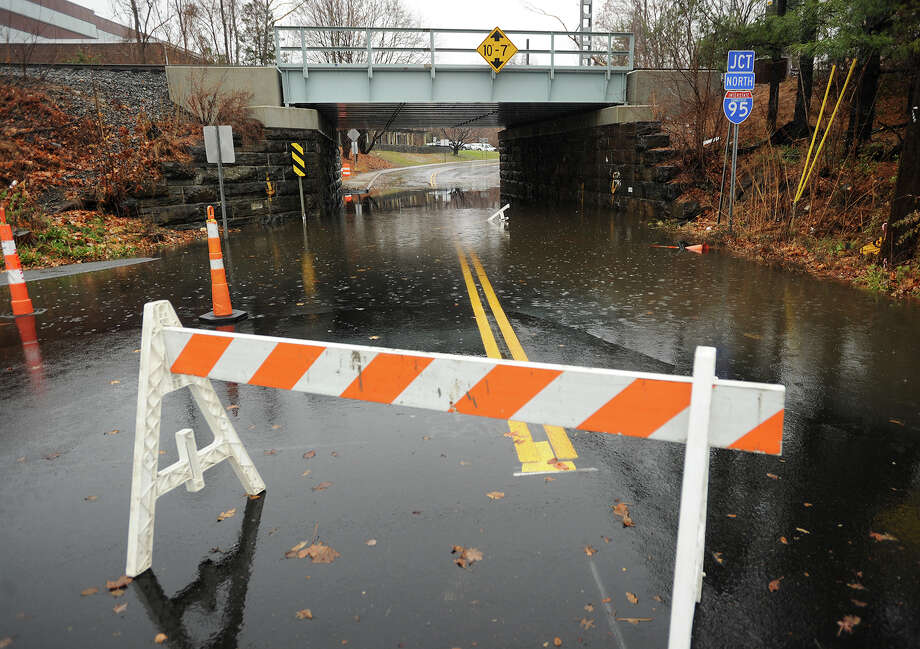 The North Benson Road viaduct  in Fairfield, Conn. is closed to traffic due to storm flooding on Wednesday, November 27, 2013. Photo: Brian A. Pounds / Connecticut Post