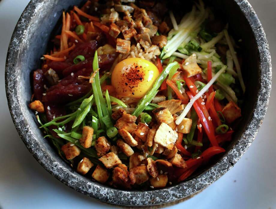 Latin BitesCuisine: PeruvianDish: The Volcano Rice dish: with pork, Chinese sausage, chicken, special rice, carrots, zucchini, red bell peppers, snow peas, green onions, white sesame seed and egg yolkEntree price: $$Where: 5709 WoodwayPhone: 713-229-8369Website: latinbitescafe.com Photo: Karen Warren, Staff / © 2013 Houston Chronicle