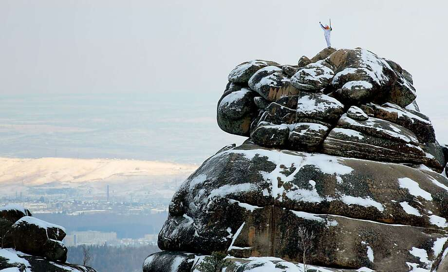What's the adventuresome Olympic torch doing now?Rock climbing at the Stolby (Pillars) national 