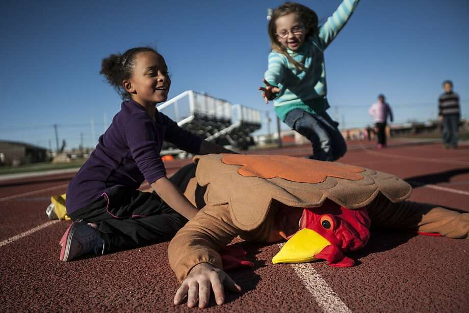Did you get the license plate? Third-grader Savannah Johnson (left) and second-grader Tillie Hunter come to the 