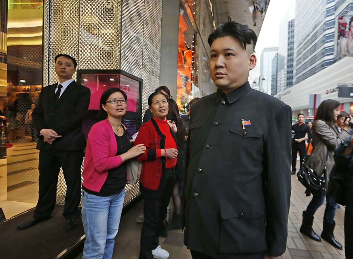 The U.S. Senate uses the nuclear option and I'm the monster? Right! A Kim Jong Un impersonator who identified himself only as Howard causes double-takes outside a Louis Vuitton store in a Hong Kong shopping district.