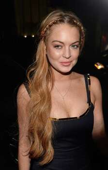 Actress Lindsay Lohan went to rehab after pleading no-contest to reckless driving and lying to police in 2013. Photo: Michael Buckner, Getty Images / 2013 Getty Images