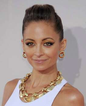 TV personality Nicole Richie reportedly checked herself into rehab after her license was revoked and drugs were found in her car in 2003. Photo: Gregg DeGuire, WireImage / 2013 Gregg DeGuire