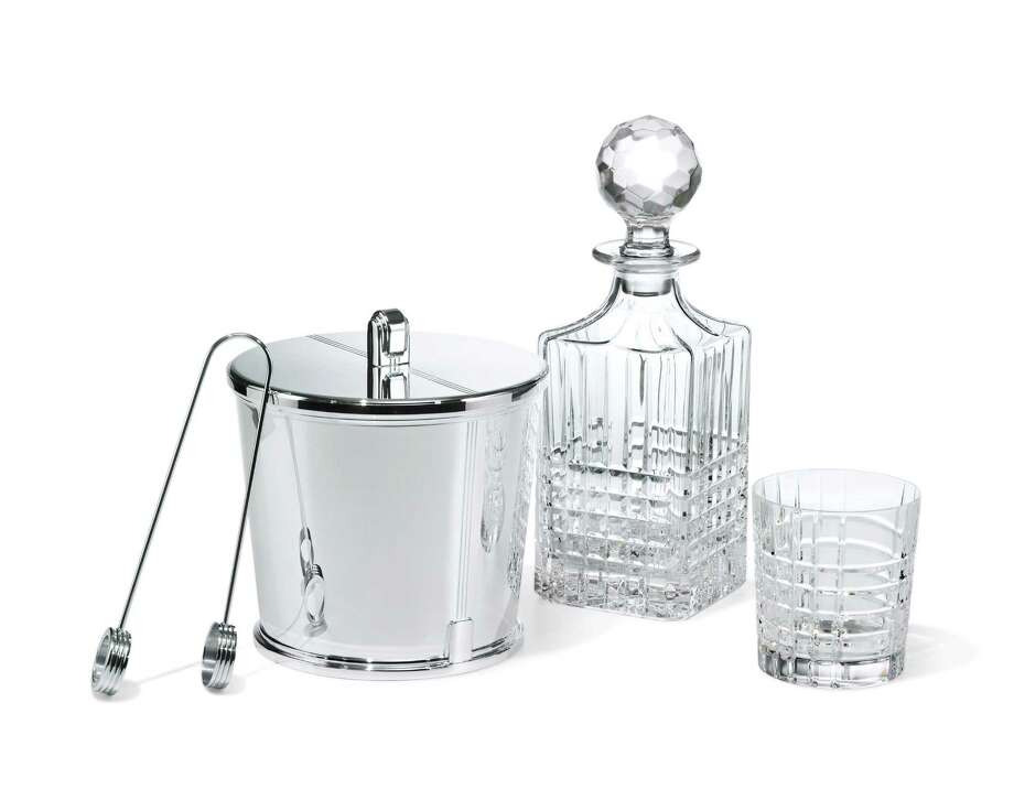 Barware pieces including Tiffany Century ice bucket, plaid-cut decanter, double old-fashioned glass in hand-cut crystal, and Paloma's Groove sterling silver ice tongs by Paloma Picasso for Tiffany & Co.; prices upon request at Tiffany & Co. in the Galleria and The Woodlands. Photo: David Lawrence / Tiffany & Co.